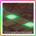 نورپردازی فضای سبز با سنگ نورانی سبز